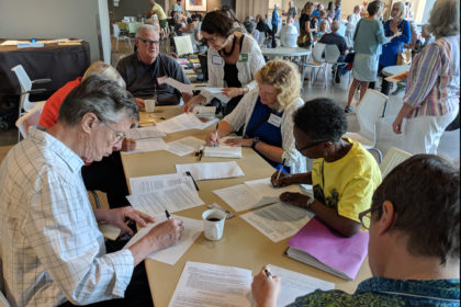 Members write letters to Congress during coffee hour