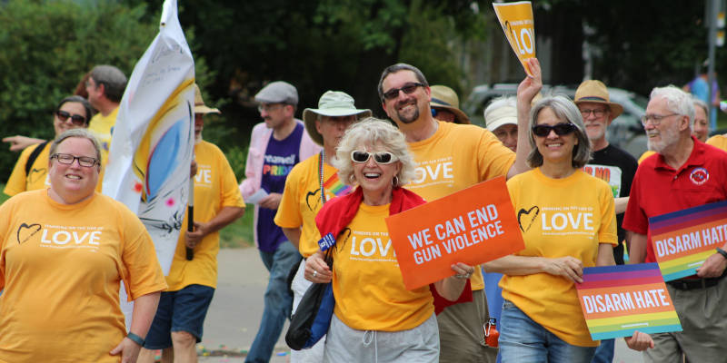 Unitarian Universalist Society members march in annual Iowa City Pride Parade